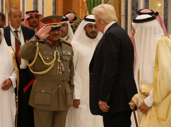 A military officer salutes U.S. President Donald Trump (2-R) and Saudi Arabia's King Salman bin Abdulaziz Al Saud (R) as they attend the Arab Islamic American Summit in Riyadh, Saudi Arabia May 21, 2017. REUTERS/Jonathan Ernst