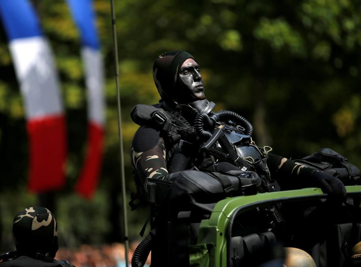 A camouflaged special forces member attends the traditional Bastille day military parade on the Champs-Elysees in Paris, France, July 14, 2017. REUTERS/Stephane Mahe