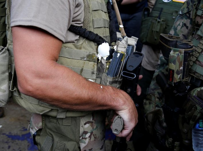 A militia member has an egg on his body armor during rally in Charlottesville, Virginia, U.S., August 12, 2017. REUTERS/Joshua Roberts