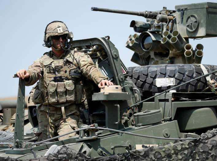 A US serviceman stands on M1126 Stryker Infantry Carrier Vehicle (ICV) during a closing ceremony of NATO-led joint military exercises Noble Partner 2017 at Vaziani Training Area outside Tbilisi, Georgia, August 12, 2017. REUTERS/David Mdzinarishvili