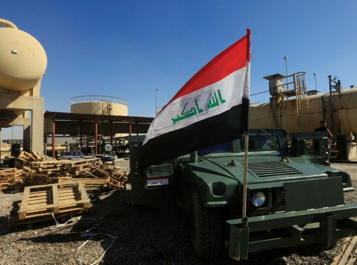 An Iraqi flag is seen on a military vehicle at an oil field in Dibis area on the outskirts of Kirkuk, Iraq October 17, 2017. REUTERS/Alaa Al-Marjani