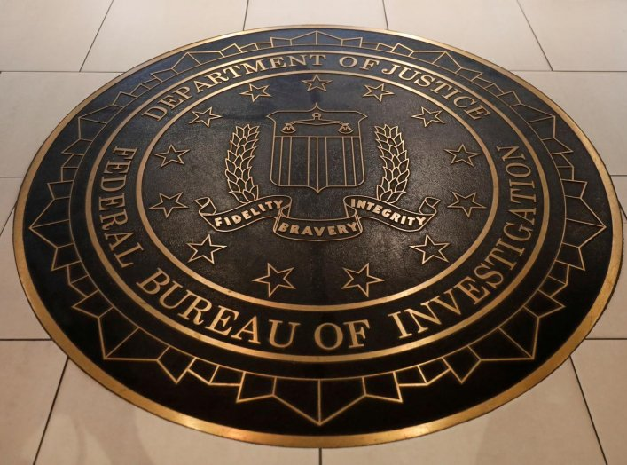 The Federal Bureau of Investigation seal is seen at FBI headquarters in Washington, U.S. June 14, 2018. REUTERS/Yuri Gripas