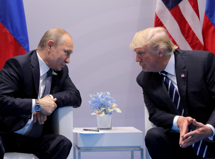 Russia's President Vladimir Putin talks to U.S. President Donald Trump during their bilateral meeting at the G20 summit in Hamburg, Germany, July 7, 2017. REUTERS/Carlos Barria