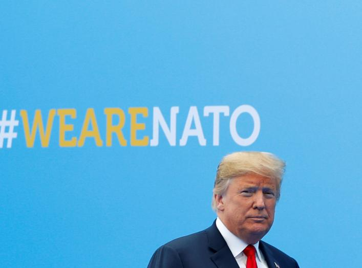 U.S. President Donald Trump walks at the start of a NATO summit at the Alliance's headquarters in Brussels, Belgium July 11, 2018. REUTERS/Paul Hanna
