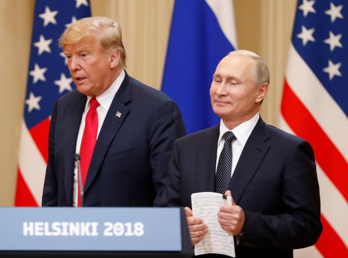 U.S. President Donald Trump and Russian President Vladimir Putin arrive for a joint news conference after their meeting in Helsinki, July 16, 2018. REUTERS/Grigory Dukor