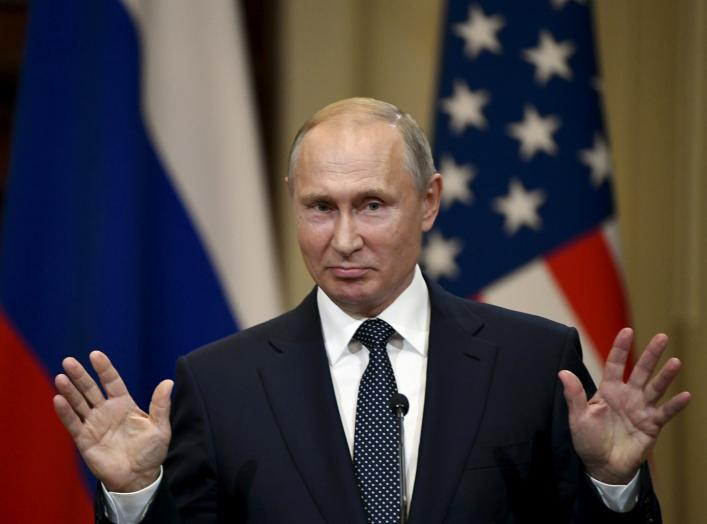 Russia's President Vladimir Putin gestures during the joint press conference with U.S. President Donald Trump in the Presidential Palace in Helsinki, Finland July 16, 2018. Lehtikuva/Jussi Nukari