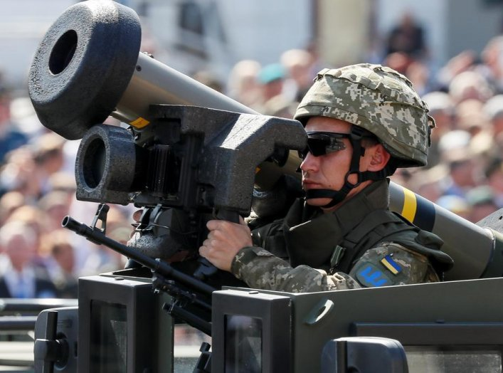 A Ukrainian army servicemember rides with a Javelin anti-tank missile during a military parade marking Ukraine's Independence Day in Kiev, Ukraine August 24, 2018. REUTERS/Gleb Garanich