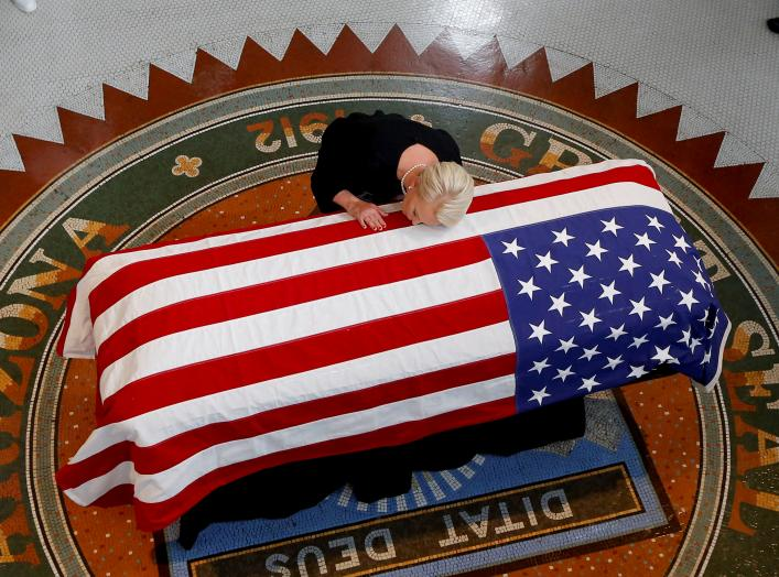 Cindy McCain, wife of U.S. Senator John McCain, touches the casket during a memorial service at the Arizona Capitol in Phoenix, Arizona, U.S., August 29, 2018. Ross D. Franklin/Pool via REUTERS