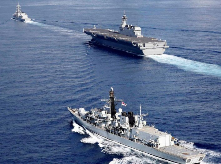 British frigate HMS Argyll (front), Japanese helicopter carrier Kaga (C) and Japanese destroyer Inazuma take part in a joint naval drill in the Indian Ocean, September 26, 2018. Picture taken on September 26, 2018. REUTERS/Kim Kyung-Hoon