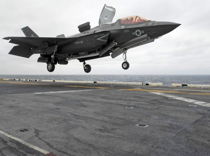 A Lockheed Martin F-35B Lightning II Joint Strike fighter jet touches down on the amphibious assault ship USS Wasp, marking the first time the aircraft has deployed aboard a U.S. Navy ship and with a Marine Expeditionary Unit in the Indo-Asian-Pacific reg
