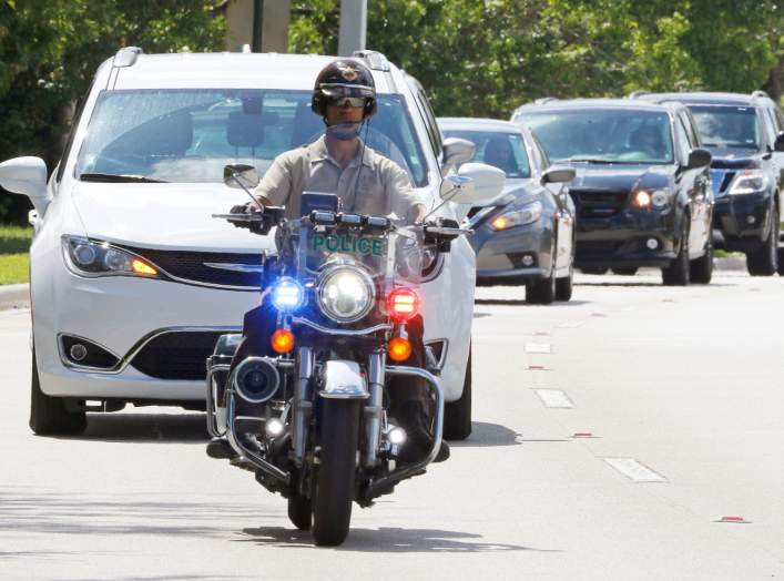 Miami-Dade police motorcycle officers escort a motorcade to FBI headquarters in Miramar, Florida, U.S. October 26, 2018. REUTERS/Joe Skipper