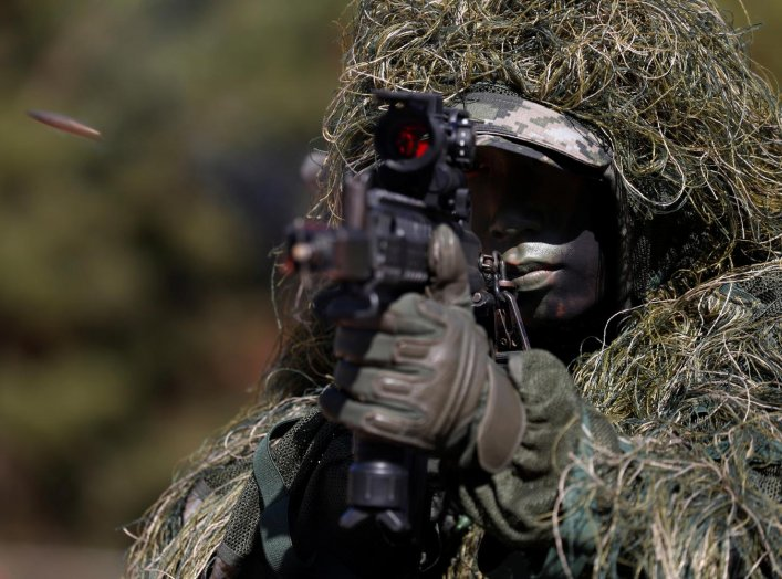 A South Korean marine in action during their regular drill on Yeonpyeong Island, South Korea November 1, 2018. Jeon Heon-Kyun/Pool via REUTERS TPX IMAGES OF THE DAY