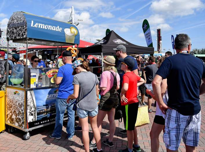 Feb 17, 2019; Daytona Beach, FL, USA; Fans line up at a lemonade stand prior to the Daytona 500 at Daytona International Speedway. Mandatory Credit: Jasen Vinlove-USA TODAY Sports