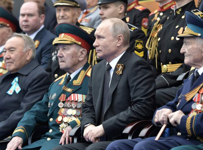 Spectators, including Russia's President Vladimir Putin and Kazakhstan's Former President Nursultan Nazarbayev, attend the Victory Day parade, which marks the anniversary of the victory over Nazi Germany in World War Two, in Red Square in central Moscow,