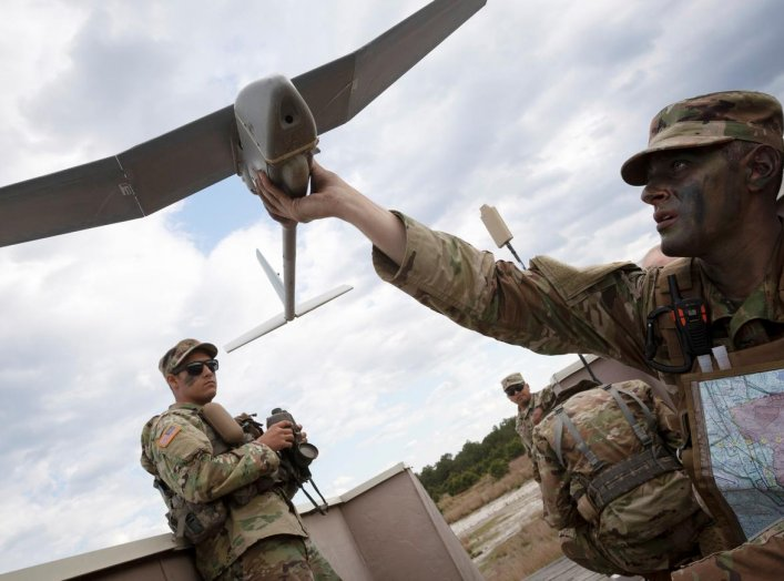 New York Army National Guard Corporal Matthew G. Mena performs a systems check on an RQ-11 Raven B, a small unmanned aerial system or drone, during the field training at Joint Base McGuire-Dix-Lakehurst, New Jersey, U.S. May 15, 2019. New Jersey National