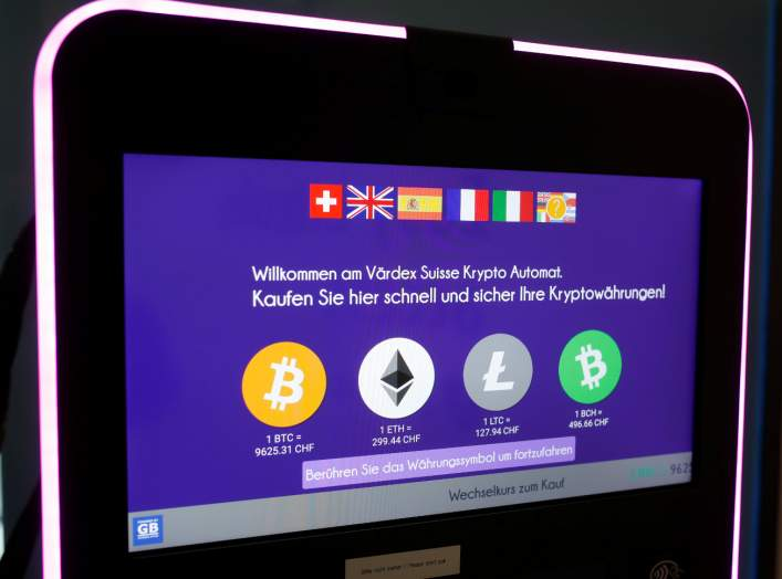 The exchange rates and logos of Bitcoin (BTH), Ether (ETH), Litecoin (LTC) and Bitcoin Cash (BCH) are seen on the display of a cryptocurrency ATM of blockchain payment service provider Vaerdex at the headquarters of Swiss Falcon Private Bank in Zurich, Sw