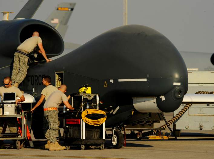 U.S. Air Force maintainers prepare a U.S. military drone RQ-4A Global Hawk for takeoff at an undisclosed location in Southwest Asia, December 2, 2010. Picture taken December 2, 2010. Courtesy Eric Harris/U.S. Air Force/Handout via REUTERS