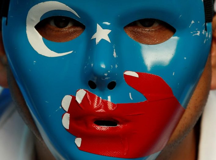 A Chinese Uyghur Muslim participates in an anti-China protest during the G20 leaders summit in Osaka, Japan June 28, 2019. REUTERS/Jorge Silva