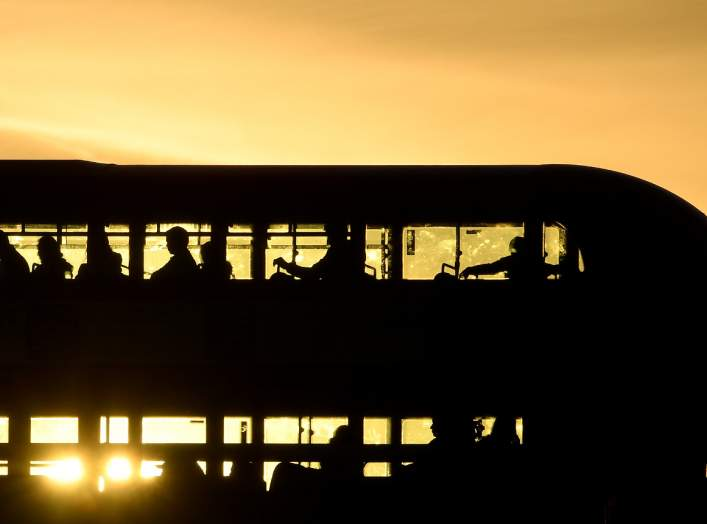 Workers are seen crossing London Bridge in a bus at sunrise in London, Britain, September 25, 2018. Picture taken September 25, 2018. To match Exclusive BRITAIN-EU/CITY REUTERS/Toby Melville