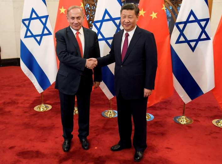 Chinese President Xi Jinping and Israeli Prime Minister Benjamin Netanyahu shake hands ahead of their talks at Diaoyutai State Guesthouse in Beijing, China March 21, 2017. Etienne Oliveau/Pool via REUTERS/File Photo