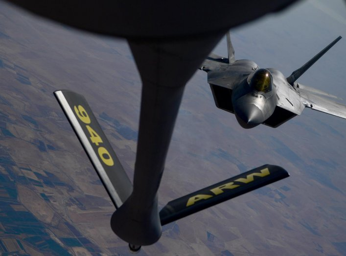 A U.S. Air Force F-22 Raptor, prepares to connect with a KC-135 Stratotanker during an aerial refueling mission above an undisclosed location, out of Al Udeid Air Base, Qatar, in this undated handout picture released by U.S. Air Force on July 29, 2019. Ch