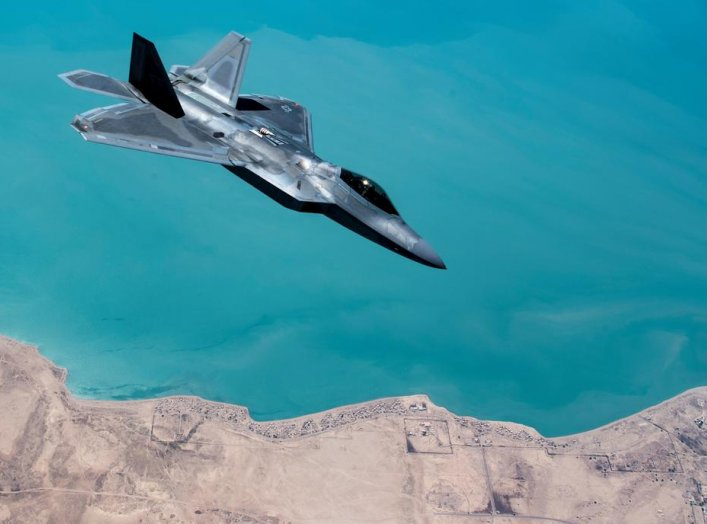 A U.S. F-22 Raptor, based out of Al Udeid Base in Doha, Qatar, receives fuel from a 28th Expeditionary Air Refuelling Squadron KC-135 Stratotanker during a combat air patrol mission over an undisclosed location in Southwest Asia, in this picture taken Sep