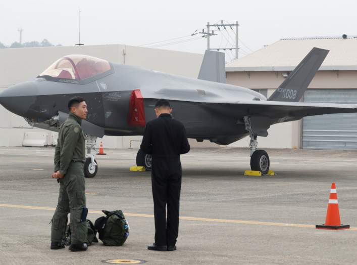 A South Korean fighter pilot (L) stands next to his F-35 stealth fighter during a ceremony to mark the 71st Armed Forces Day at the Air Force Base in Daegu, South Korea, October 1, 2019. Jeon Heon-kyun/Pool via REUTERS