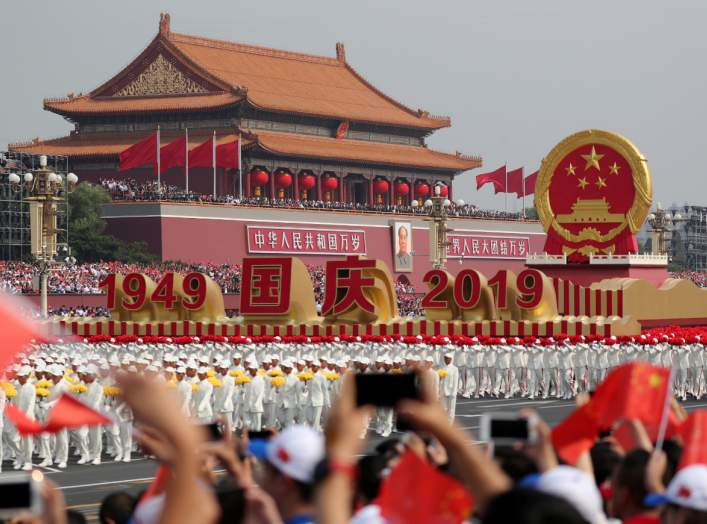 A float featuring China's national emblem travels past Tian'anmen Gate during a parade marking the 70th anniversary of the founding of the People's Republic of China, on its National Day in Beijing, China October 1, 2019. China Daily via REUTERS