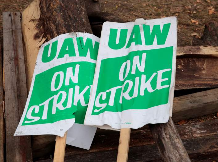 """UAW on strike"" picket signs lay on a pile of wood outside the General Motors Detroit-Hamtramck Assembly in Hamtramck, Michigan, U.S. October 25, 2019. REUTERS/Rebecca Cook"