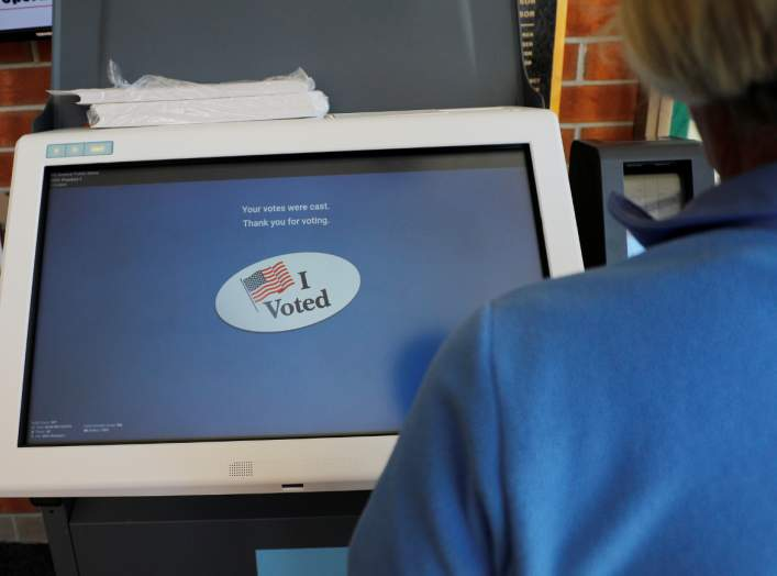 "The screen reads ""I Voted"" after a voter went through a practice session with the new Election Systems & Software ExpressVote XL voting machine, an electronic voting system with a backup paper trail, in Hanover Township, Pennsylvania, U.S.,"