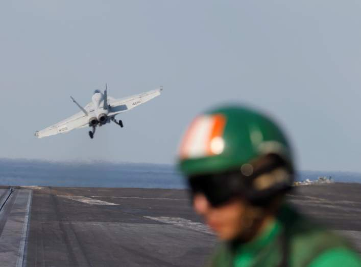 An EA-18E Super Hornet is catapulted off from the flight deck of the aircraft carrier USS Abraham Lincoln (CVN 72) in the Gulf, November 23, 2019. REUTERS/Hamad I Mohammed