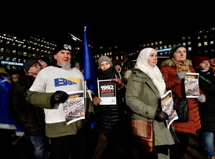 Protesters hold posters at a demonstration against the awarding of the 2019 Nobel literature prize to Peter Handke in Stockholm, Sweden December 10, 2019. TT News Agency/Stina Stjernkvist via REUTERS