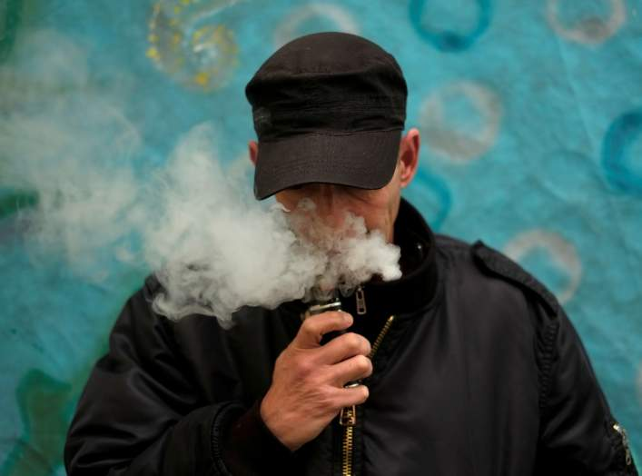 FILE PHOTO: A man poses for a picture, as he vapes at home in La Paz, Bolivia, February 2, 2019. REUTERS/David Mercado/File Photo
