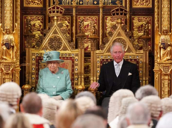 Britain's Queen Elizabeth sits on the Sovereign's Throne next to Prince Charles before reading the Queen's Speech during the State Opening of Parliament at the Houses of Parliament in London, Britain December 19, 2019. REUTERS/Hannah McKay/Pool