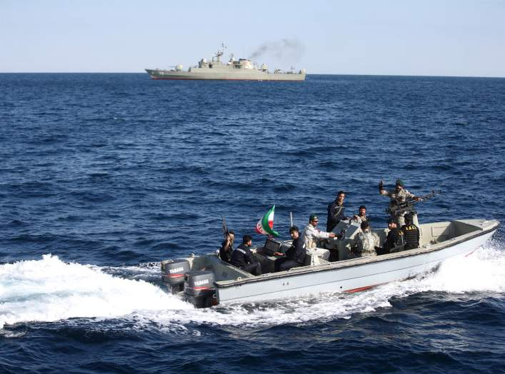 Iranian marine soldiers wave to the camera from a motor boat in the Sea of Oman during the third day of joint Iran, Russia and China naval war games in Chabahar port, at the Sea of Oman, Iran, December 29, 2019. Mohsen Ataei/Fars news agency/WANA (West As