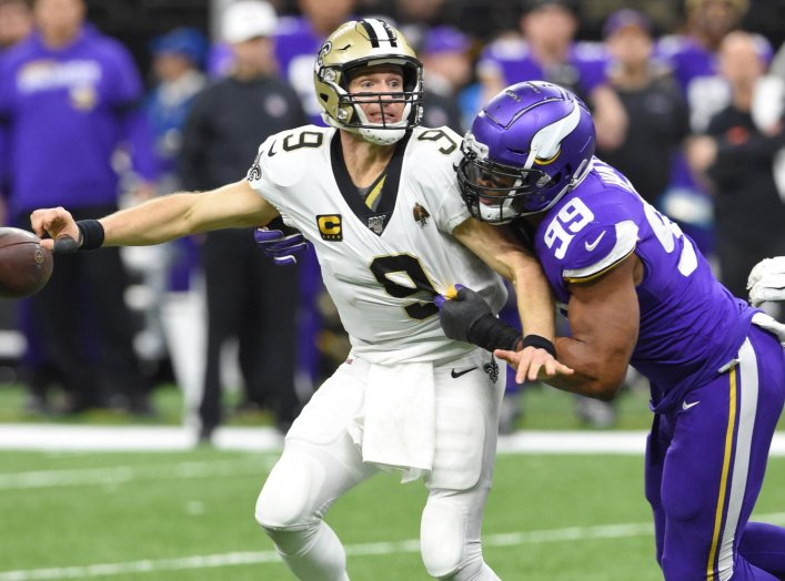New Orleans Saints quarterback Drew Brees (9) fumbles the ball as he is hit by Minnesota Vikings defensive end Danielle Hunter (99) during the fourth quarter of a NFC Wild Card playoff football game at the Mercedes-Benz Superdome, New Orleans, Louisiana,