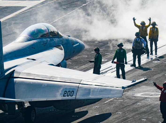 Sailors carry out pre-flight checks on an F/A-18F Super Hornet on the flight deck of the U.S. Navy aircraft carrier USS Harry S. Truman in the Arabian Sea January 6, 2020. Picture taken January 6, 2020. U.S. Navy/Mass Communication Specialist 3rd Class Ka