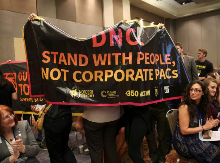 FILE PHOTO: Demonstrators with the group Sunrise Movement interrupt a resolutions meeting at the Democratic National Committee (DNC) Summer Meeting in Chicago, Illinois, U.S., August 23, 2018. REUTERS/Daniel Acker/File Photo