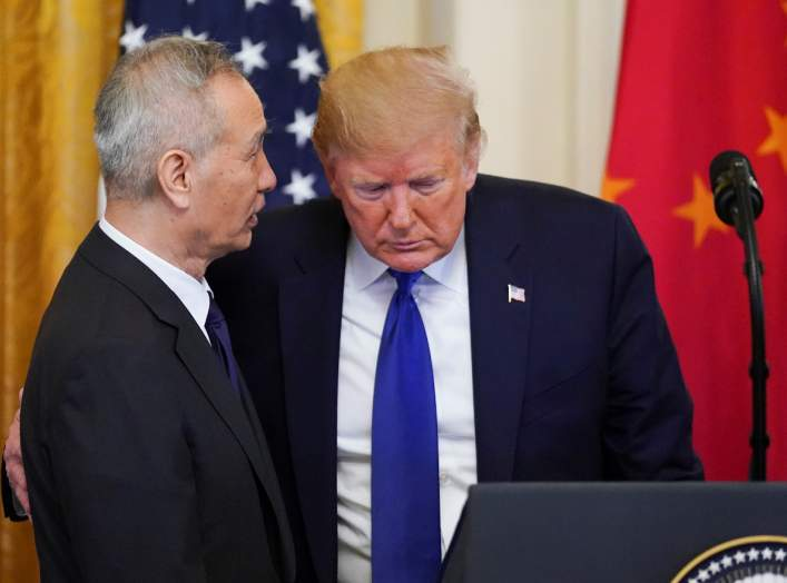 "Chinese Vice Premier Liu He talks with U.S. President Donald Trump during a signing ceremony for ""phase one"" of the U.S.-China trade agreement in the East Room of the White House in Washington, U.S., January 15, 2020. REUTERS/Kevin Lamarque"