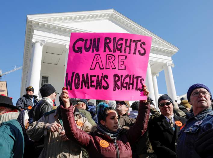 A activist holds up a sign supporting gun rights for women during a rally inside the no-gun zone in front of the Virginia State Capitol building in Richmond, Virginia, U.S. January 20, 2020. REUTERS/Jonathan Drake