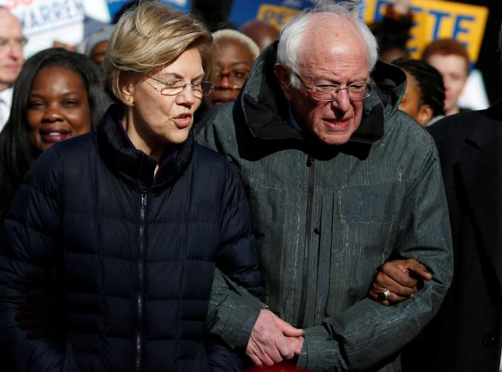 Seven of the Democratic US Presidential candidates including U.S. Senator Elizabeth Warren and Sen. Bernie Sanders, walk arm-in-arm with local African-American leaders during the Martin Luther King Jr. (MLK) Day Parade in Columbia, South Carolina