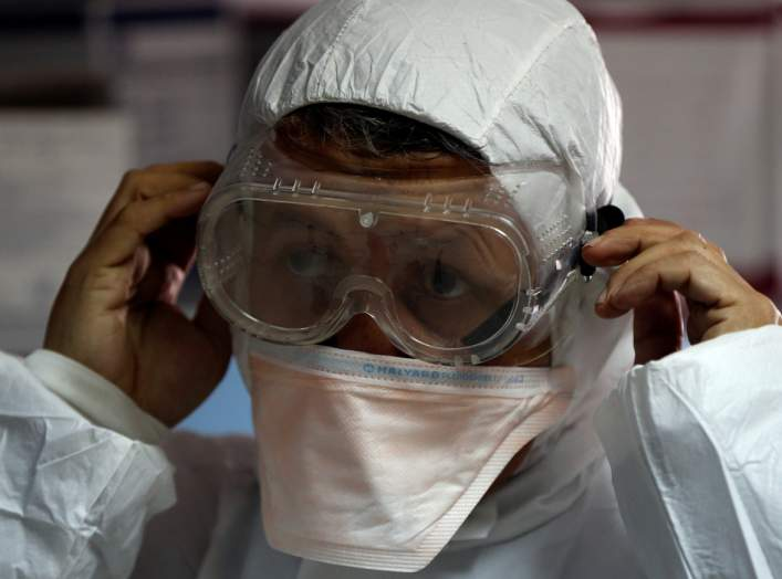 A member of the medical staff puts on protective gear at a new section specialised in receiving any person who may have been infected with coronavirus, at the Al-Bashir Governmental Hospital in Amman, Jordan January 28, 2020.REUTERS/Muhammad Hamed