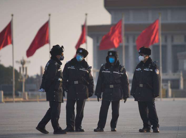 Police officers wearing masks are seen at at the Tiananmen Square, as the country is hit by an epidemic of the new coronavirus, in Beijing, China January 30, 2020. REUTERS/Stringer