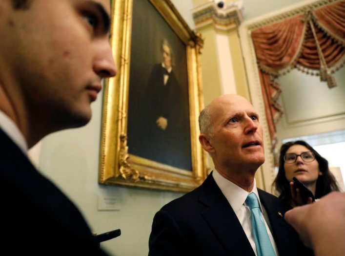 U.S. Senator Rick Scott (R-FL) speaks to media as he arrives for the resumption of the Senate impeachment trial of U.S. President Donald Trump at the U.S. Capitol in Washington, U.S., January 31, 2020. REUTERS/Brendan McDermid?