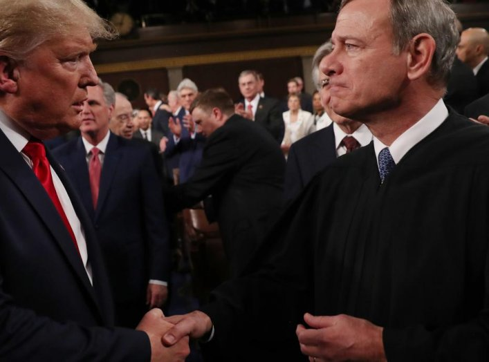 U.S. President Donald Trump greets Supreme Court Chief Justice John Roberts as he arrives to deliver his State of the Union address to a joint session of the U.S. Congress in the House Chamber of the U.S. Capitol in Washington, U.S. February 4, 2020. REUT