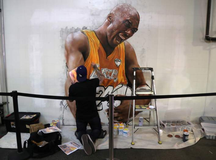 Muralist Jonas Never paints a portrait of late retired basketball player Kobe Bryant at the Grand Central Market in Los Angeles, California, U.S. February 5, 2020. REUTERS/Chris Helgren
