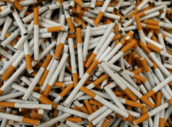 FILE PHOTO: Cigarettes are seen during the manufacturing process in the British American Tobacco Cigarette Factory (BAT) in Bayreuth, southern Germany, April 30, 2014. Picture taken April 30, 2014. REUTERS/Michaela Rehle/File Photo