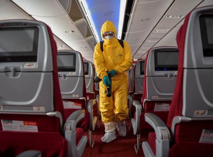 A man in protective suit works on disinfecting the aircraft cabin for a Hainan Airlines flight, as the country is hit by an outbreak of the novel coronavirus, at the Haikou Meilan International Airport in Haikou, Hainan province, China February 7, 2020.