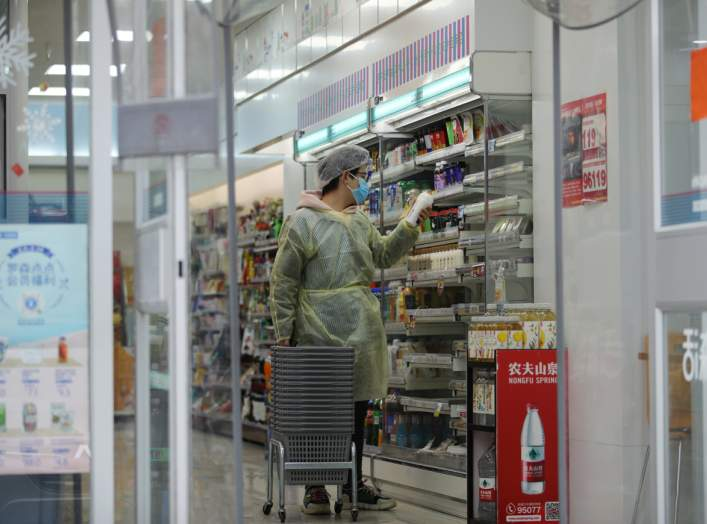 A worker is seen inside a convenience store following an outbreak of the novel coronavirus in Wuhan, Hubei province, China February 11, 2020. REUTERS/Stringer