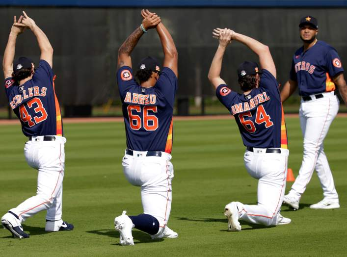 West Palm Beach, Florida, USA; Houston Astros pitcher Lance McCullers Jr (43) and pitcher Bryan Abreu (66) and pitcher Kent Emanuel (64) and pitcher Josh James (right) stretch during a spring training workout at FITTEAM Ballpark. Feb 14, 2020; Rhona Wise-